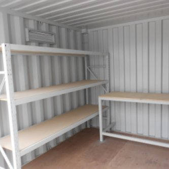 Inside of 10ft with custom shelving & workbench