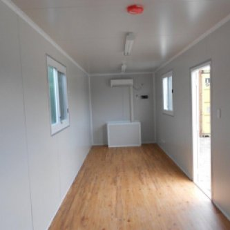 Interior of 40 foot Site Container with Storage Space, Wood floors, White walls