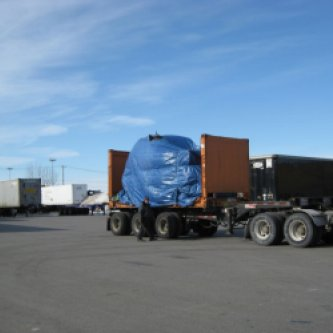 High Cube Flatrack carrying a vehicle