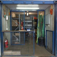 Secure equipment rack with storage
